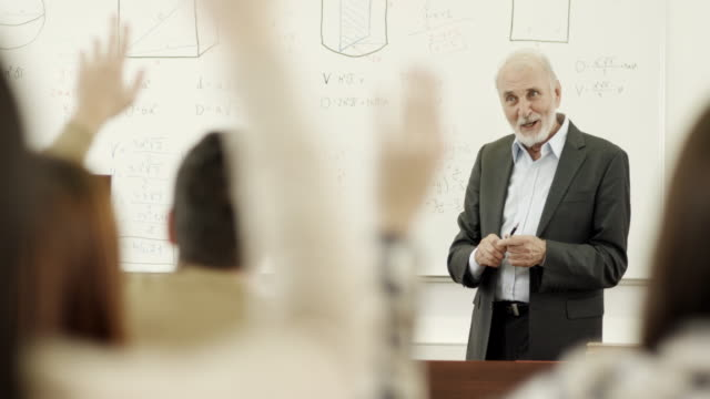professor and students in the classroom - professor stock videos & royalty-free footage