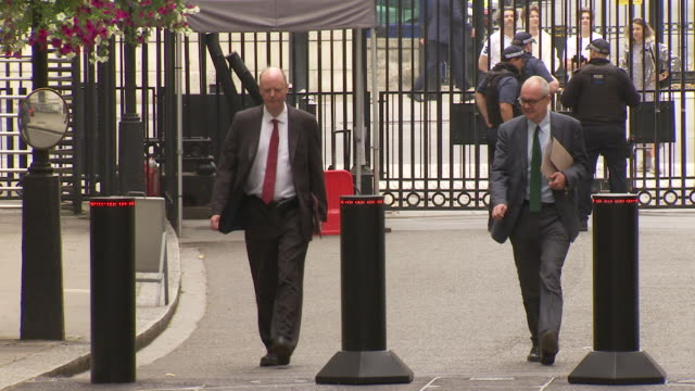 """professor chris whitty and sir patrick vallance uk government chief medical and scientific advisers arrive at 10 downing street for press conference... - """"bbc news"""" stock videos & royalty-free footage"""