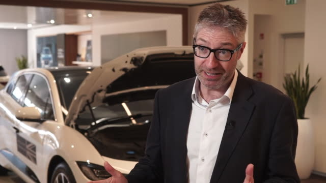 professor david bailey of birmingham business school saying it is a shame britain is punching below its weight in the automative industry because of... - midlands occidentali video stock e b–roll