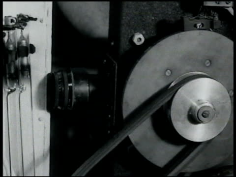 professor edgerton & assistant w/ high speed stroboscopic camera & showing how it works. strobing light belt driven film advance . - 1935 stock videos & royalty-free footage