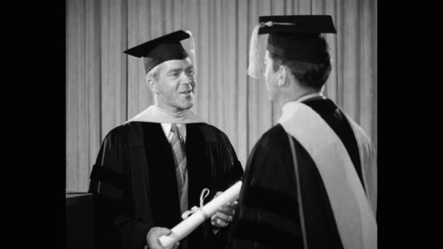 professor giving graduation certificate to student on graduation day - cap stock videos & royalty-free footage