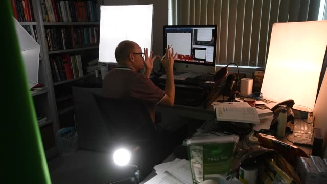 stockvideo's en b-roll-footage met professor of physics and astronomy dr. jason steffen teaches a remote physics for scientists and engineers course from his office at unlv amid the... - de ruimte en astronomie