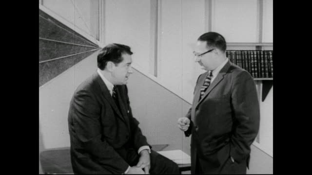 1960 professor philip hauser talks with george stone about the importance of the us census - explaining stock videos & royalty-free footage