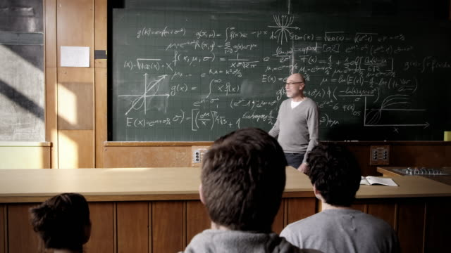 professor talking to students - mathematics stock videos and b-roll footage