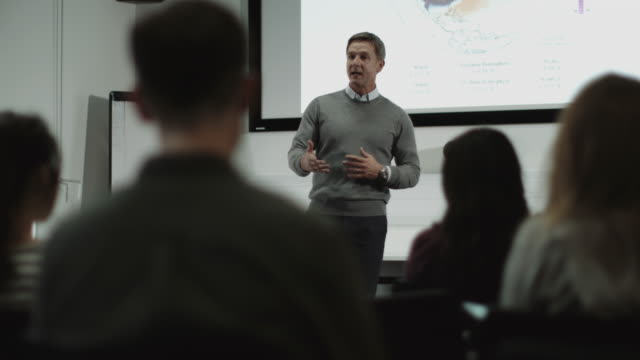 Professor teaching with projector