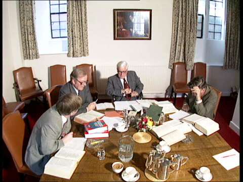40 professor william mchardy cambridge seated round table with others discussing psalm 23 ext 0822 professors walk towards gv's cambridge buildings... - psalms stock videos and b-roll footage