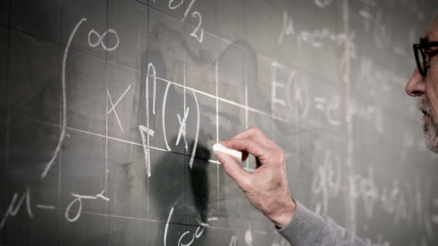 professor writing on blackboard - formula stock videos & royalty-free footage