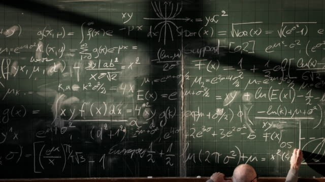 professor writing on blackboard (timelapse) - lecturer stock videos & royalty-free footage
