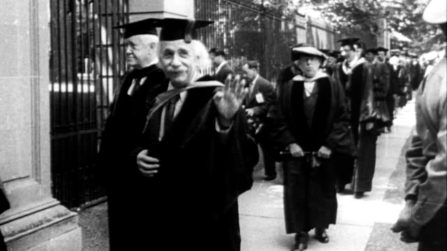 vídeos de stock, filmes e b-roll de professors at princeton university walking during commencement ceremony / albert einstein walking with other professors albert einstein at princeton... - albert einstein