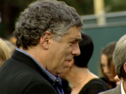 profile, elliot gould in crowd conversing with various people outdoors at hollywood bowl - エリオット グールド点の映像素材/bロール