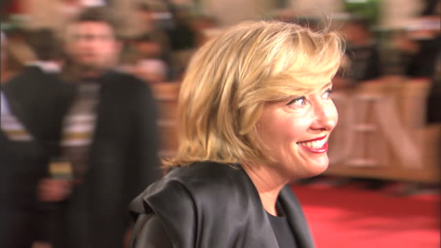profile cu emma thompson smiling and waving as she walks over begins interviewing with reporters speaking into several microphones zo to ms - emma thompson stock videos & royalty-free footage