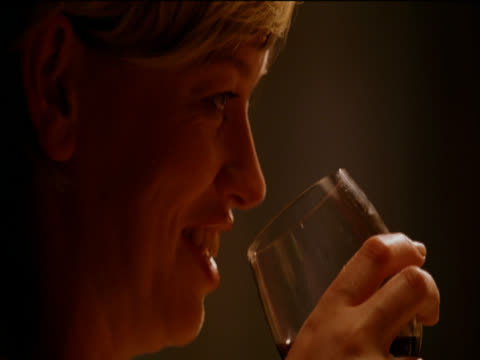 profile headshot of a woman talking, smiling and drinking red wine - only mid adult women stock videos & royalty-free footage