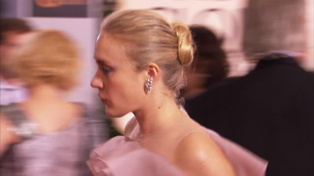 profile MCU ZO MS Chloe Sevigny waves to paparazzi as she walks down red carpet
