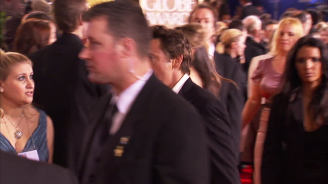 profile MCU Robert Downey Jr with wife Susan walking down the red carpet
