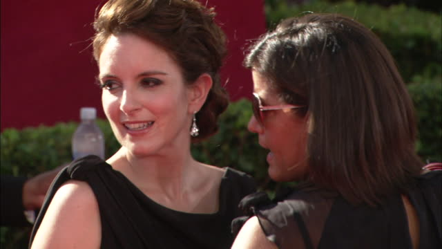profile MCU Tina Fey posing for paparazzi on red carpet and speaking to handlers