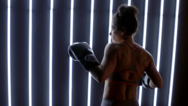 profile mid shot on young woman practicing boxing in slow motion 4k - vesper stock stock videos & royalty-free footage