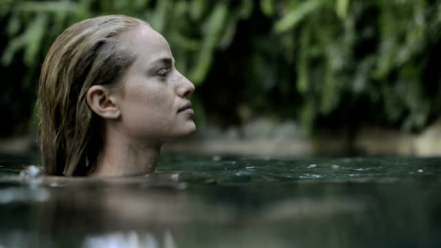 Profile of a young woman in the water