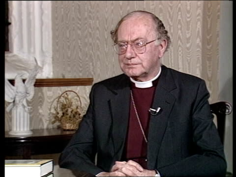profile of archbishop of canterbury robert runcie; cms gerald priestland intvw continues sof lambeth palace: side runcie at desk, stands and walks... - robert runcie stock videos & royalty-free footage