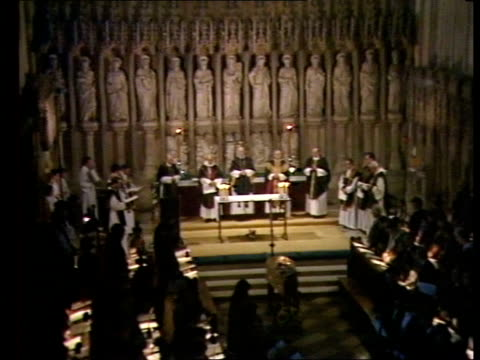 profile of archbishop of canterbury robert runcie; tx 15.12.87 oxfordshire: oxford: tms gary bennet's coffin during funeral service tms clergy at... - robert runcie stock videos & royalty-free footage