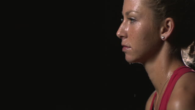 stockvideo's en b-roll-footage met slo mo, cu, tu, profile of exhausted female tennis player at night, santa barbara, california, usa - profiel