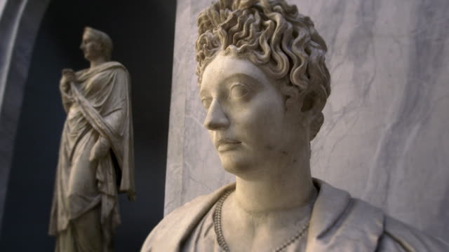 profile of female bust with statue in background. - sculpture stock-videos und b-roll-filmmaterial