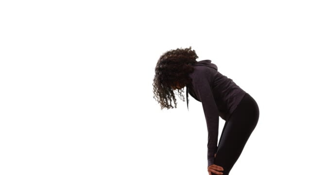 stockvideo's en b-roll-footage met profile of fit black female jogger resting hands on knees on white background - jogster
