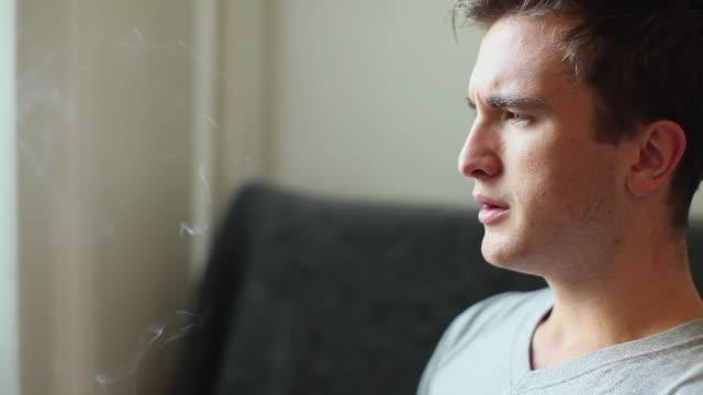 CU Profile of man smoking medicinal marijuana joint / Simi Valley, California, USA