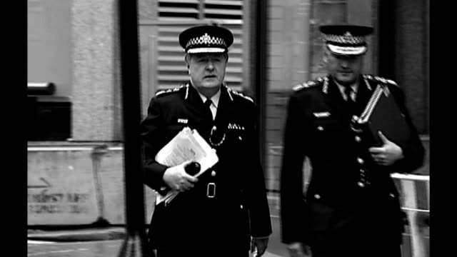 profile of outgoing metropolitan police commissioner sir paul stephenson; t28010903 b/w graphicised shot of sir ian blair and stephenson along - b rolle stock-videos und b-roll-filmmaterial