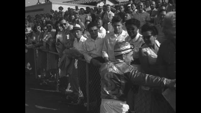 profile of record setting jockey john longden / horses leave starting gate / longden on big rush / longden walking past wellwishing crowd / longden... - plakette stock-videos und b-roll-filmmaterial