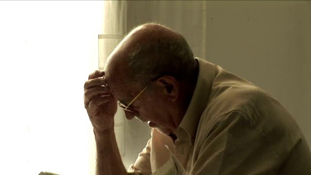 CU Profile of senior man reading, Bilbao, Spain