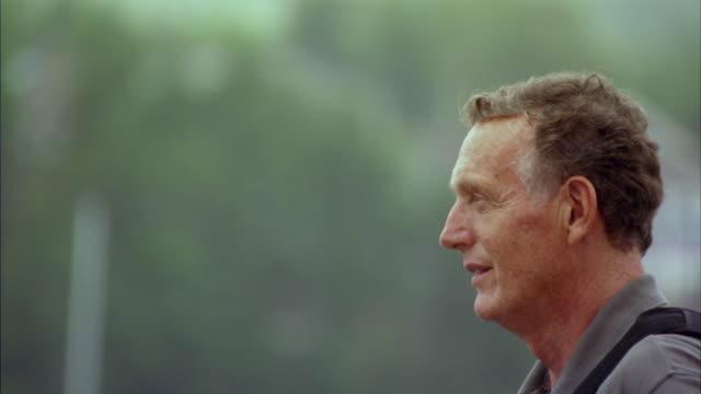 cu td profile of senior man wearing life jacket, halifax, nova scotia, canada - 横顔点の映像素材/bロール