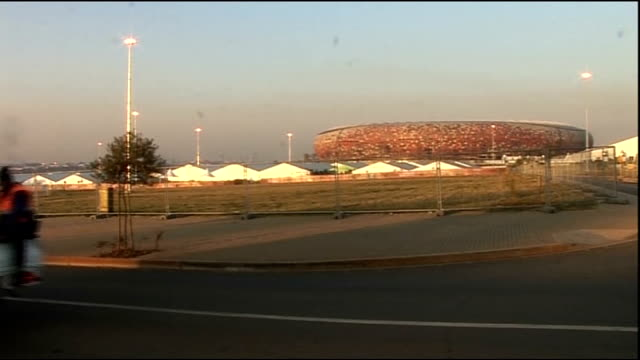profile of south africa's captain aaron mokoena south africa johannesburg soweto ext workers on back of pick up truck along past soccer city world... - aaron mokoena stock videos & royalty-free footage