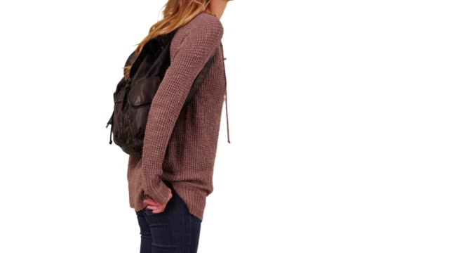profile of white millennial girl waiting with backpack in studio with copyspace - hands in pockets stock videos & royalty-free footage