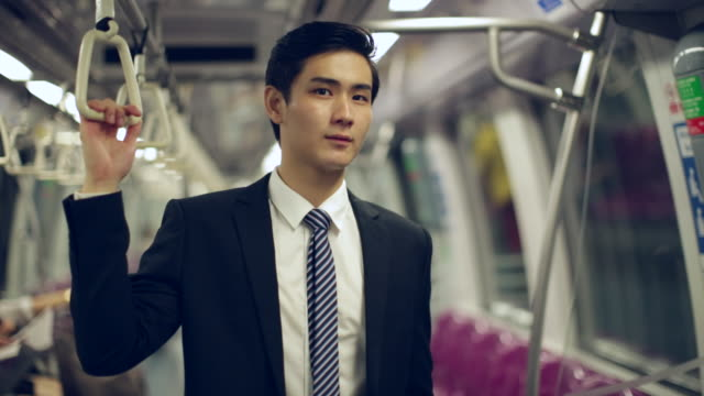 MS Profile of young businessman on subway train