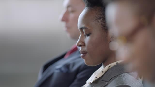 vídeos y material grabado en eventos de stock de slo mo. cu. profile portrait of smiling african-american businesswoman with tablet seated amongst travelers. - negocio corporativo