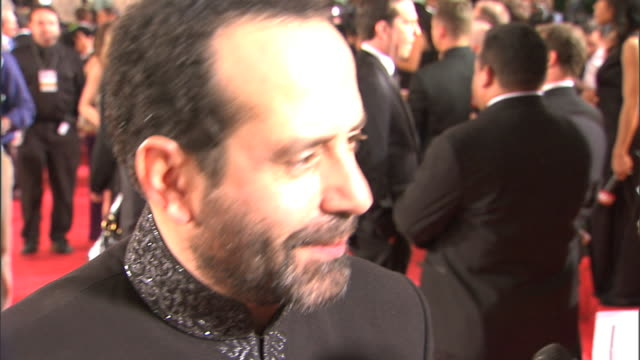 profile CU Tony Shalhoub interviewing with unseen reporter