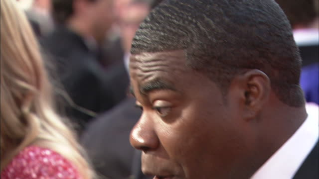 profile CU Tracy Morgan talking to reporter on the red carpet