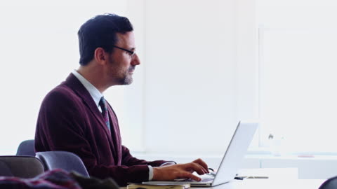 profile view of man using laptop - profile stock videos & royalty-free footage