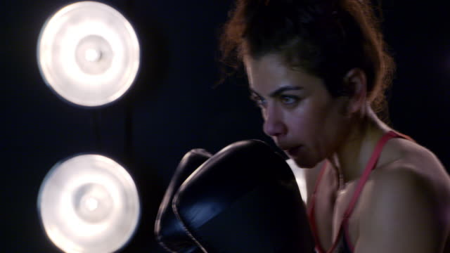 profile view of young woman practicing boxing in slow motion 4k - vesper stock stock videos & royalty-free footage