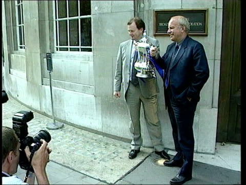 profiles/reaction lib ext seq greg dyke posing with fa cup after winning television rights to screen fa cup matches seq greg dyke sitting next to fa... - greg dyke stock videos & royalty-free footage