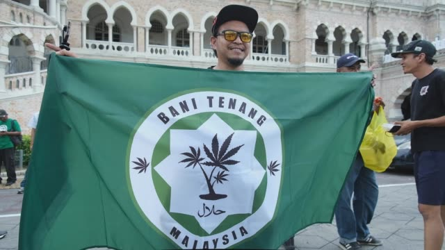 pro-ganja activists gather at the independence square to show their solidarity to their friends for the death sentence on february 22, 2020 in kuala... - substance abuse stock videos & royalty-free footage