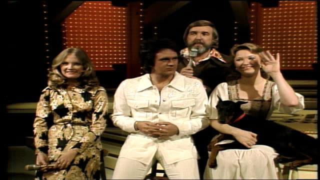 program host ralph emery with guests megan tg sheppard and tanya tucker / tanya tucker holds her doberman pinscher named babe / tanya's band plays... - pure bred dog stock videos and b-roll footage