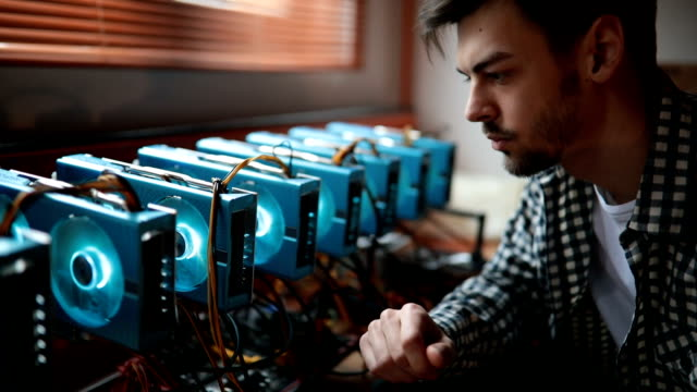 programmer preparing rig for cryptocurrency mining - financial technology stock videos & royalty-free footage