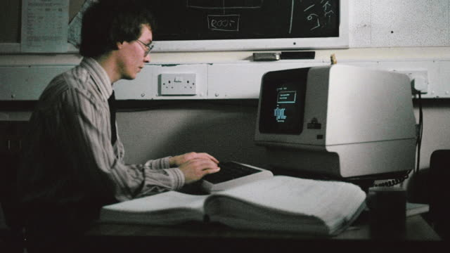 1982 ms programmer processing information on computer / united kingdom - computer language stock videos & royalty-free footage