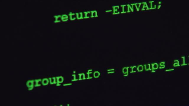 programmer typing code commands down scrolling computer screen. - computersprache stock-videos und b-roll-filmmaterial