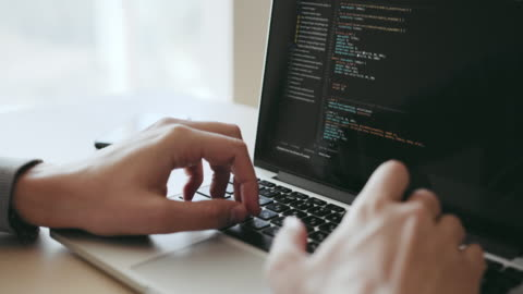programmer working in office writing programming code - finland stock videos & royalty-free footage