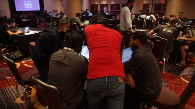 programmers and developers participate in a hackathon as part of the yahoo mobil developers conference at the marriott hotel in new york city tuesday... - yahoo brand name stock videos & royalty-free footage