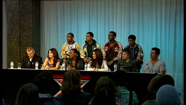 x factor finalists photocall england london factor finalists jls alexandra burke and eoghan quigg into press conference x factor finalists and judges... - finalist stock videos and b-roll footage