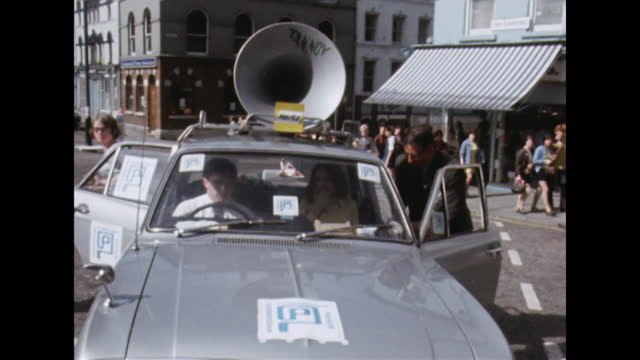 progress through peace campaigners arrive in car with tannoy speaker in londonderry, northern ireland; 1969. - progress stock videos & royalty-free footage