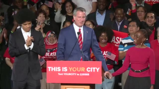 Progressive Democrat Bill de Blasio cruised to re election for a second term as mayor of New York on Tuesday US media reported riding a wave of...